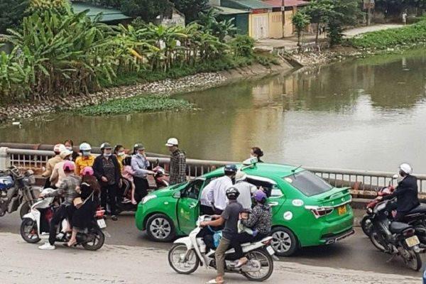 anh1-tai-xe-taxi-lao-minh-xuong-song-cuu-song-co-gai-tu-tu.jpg