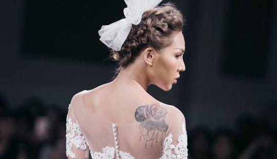 Minh Triệu lộ hình xăm khi diện váy cưới gợi cảm
