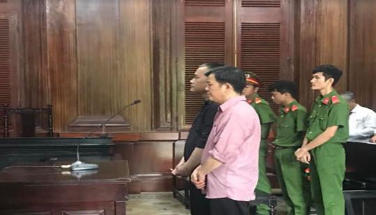 Lưu hành 100 ngàn USD giả, hai đối tượng lãnh 23 năm tù