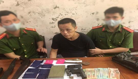 Bắt đối tượng người Lào mang ma túy kèm vũ khí nóng
