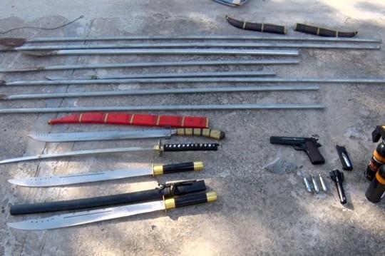 Xử lý nhóm thanh niên chuẩn bị súng và mã tấu để hỗn chiến