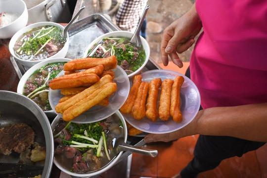 Từ 6h ngày 14/10, Hà Nội cho phép cửa hàng ăn uống bán tại chỗ